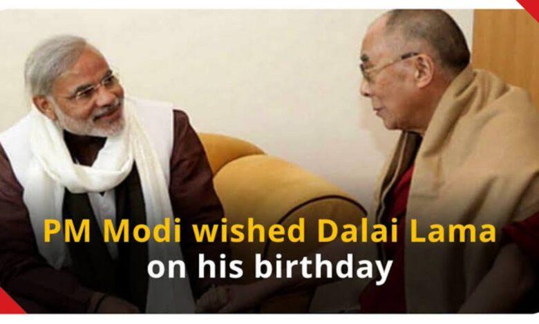 PM Modi wishing the Dalai Lama